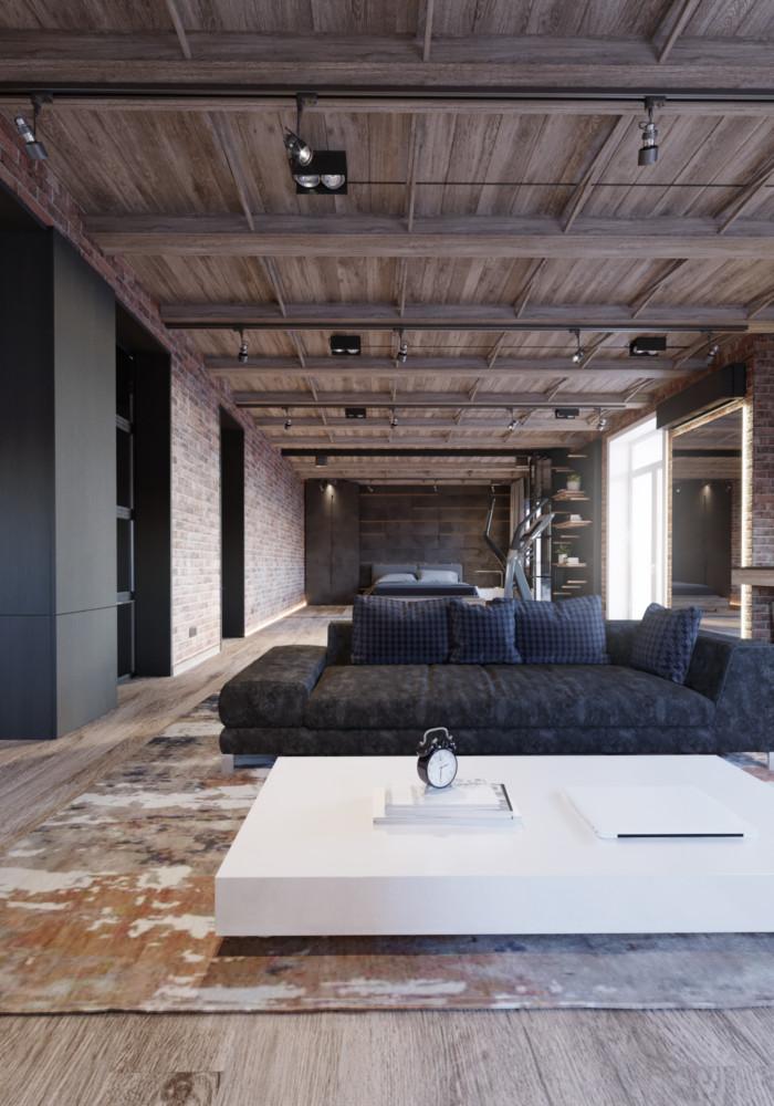 Удобный, обтянутый нубуком диван стал главным «героем» зоны гостиной. Он лаконично дополнен широким журнальным столиком контрастного на фоне общей отделки белого цвета.