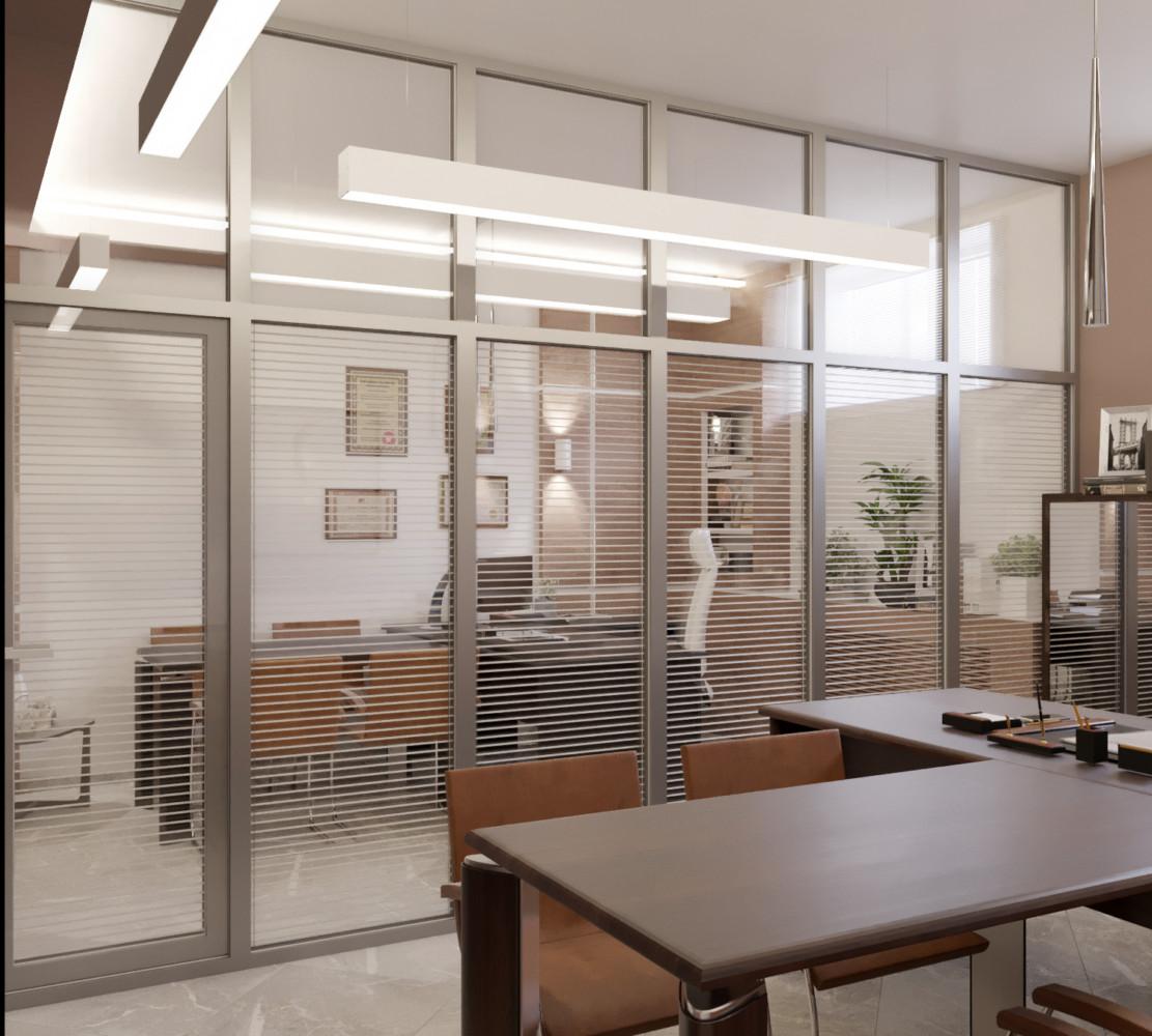 Общее пространство поделено на два кабинета стеклянной перегородкой.