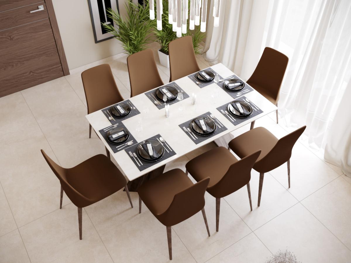 Столешница обеденного стола выполнена из искусственного камня.