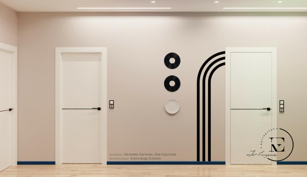 Черно-белое цветовое решение для холла выполнено очень интересно. Черная графика на стене и виниловые пластинки в виде постеров хорошо сочетаются с черными плинтусами и поперечными полосками на дверях. Красивое обрамление выключателей темными рамками выглядит очень стильно.